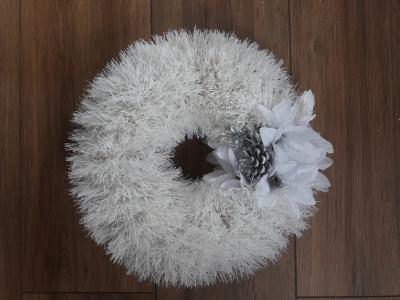 Polystyrene wreath decorated with white tinsel and decorated with a silver apple pick. £15.00